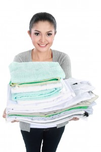 woman with clean laundry after wash